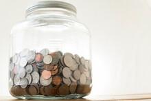 Big Jar Full Of Coins