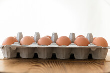 Carton Of Eggs On Wooden Table