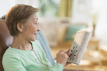 Senior Woman Doing Crossword P...