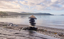 Pebbles Stacked On Driftwood O...