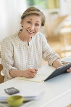 Senior Woman Using Tablet Pc A...