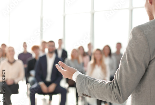 image of a speaker giving a lecture at a business seminar Canvas Print