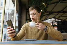 Businessman With Smartphone Us...