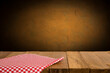 canvas print picture - Background with wooden table, tablecloth and grunge red wall
