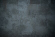 dark dirty concrete background texture stained with blue tint and copy space