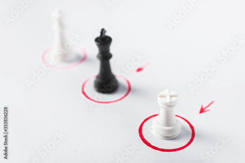 Cuadros en Lienzo Chess pieces on a white background with red special round places