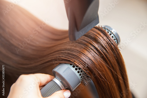 Papel de parede Close-up of hair dryer, concept cut salon, female stylist