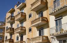 VALLETTA, MALTA - NOVEMBER 15TH 2019: Balconies With Stone Balustrades On A Maltese Apartment Block
