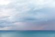 Aerial view of heavy rain clouds over Tasman sea horizon