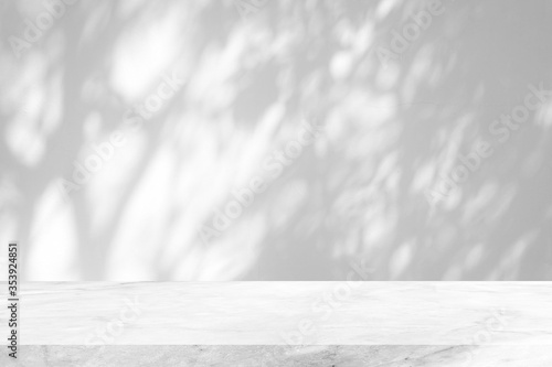 White Marble Table with Tree Shadow on Concrete Wall Texture Background, Suitable for Product Presentation Backdrop, Display, and Mock up Fotobehang