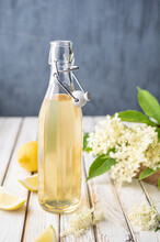 Delicious Healthy Refreshing Beverage, Sweet Elderflower Syrup Or Cordial In A Glass Bottle