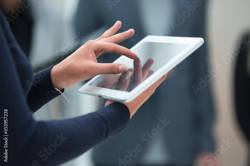 Fotografiet close up. digital tablet in the hands of a business woman