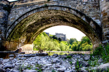 Looking Under A Stone Bridge W...