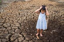 Sad Girl Standing At Dry Crack...