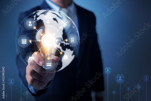 Innovation and idea of professional leader holding lighting bulb,thinking management concept with business icon line and connection