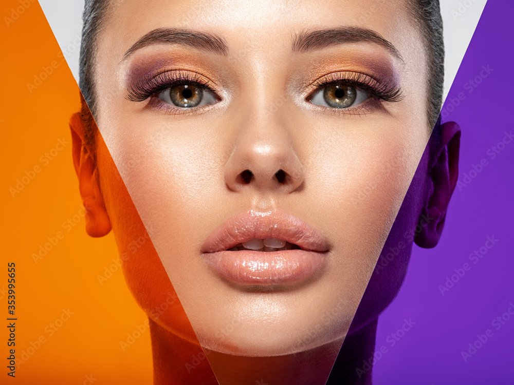 Fototapeta Beautiful white girl with bright eye-makeup. Beautiful fashion woman with  a colored  items.   Glamour fashion model with bright gloss make-up posing at studio. Stylish fashionable concept. Art.