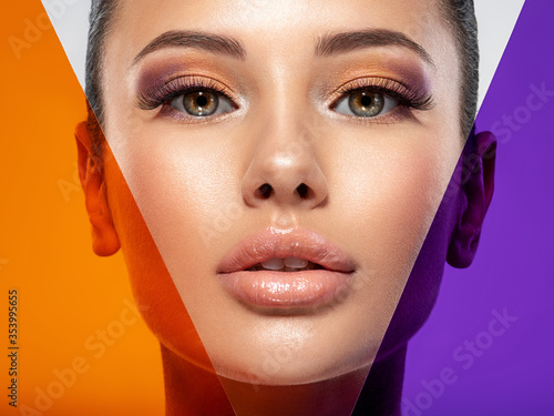 Obraz Beautiful white girl with bright eye-makeup. Beautiful fashion woman with  a colored  items.   Glamour fashion model with bright gloss make-up posing at studio. Stylish fashionable concept. Art. - fototapety do salonu