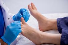 Podiatrist Treating Feet Durin...
