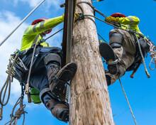 Lineman Asending Utility Pole