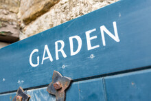 Whitby, England - 3rd May 2019: Old Retro Painted Garden Sign On A Gate
