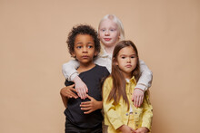 Portrait Of Adorable Diverse Children Isolated. Afro American, Albino And European Children Stand Together, Close Friendship Between Them. People Diversity, Children, Natural Beauty Concept