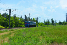 Ukrainian Shunting Metal Blue Train Travels By Rail And Is Lit By Sunlight.