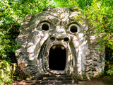 Stunning view of Orcus Mouth, a grotesque sculpture at famous Park of the Monsters, also named Sacred Grove, Bomarzo Gardens, province of Viterbo, Lazio, Italy