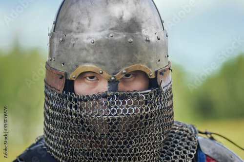 Fotografie, Obraz Close up face of asian warrior in eastern medieval helmet