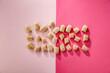 Leinwandbild Motiv Aerial view of sweet cakes on a pink background