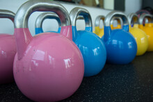 A Set Of Colorful Kettlebells