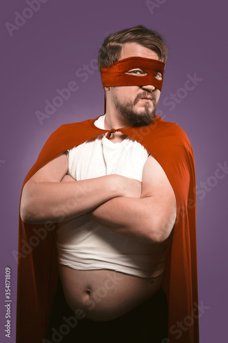 Super hero man with crossed arms and opened tummy looking at camera Fototapet