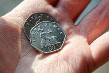 Person Holding 2 Fifty Pence C...