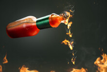 Burning Hot Chili Sauce Dripping From A Bottle