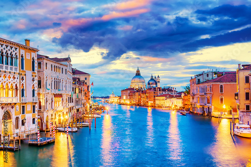 Fototapeta Basilica Santa Maria della Salute, Punta della Dogona and Grand Canal at blue hour sunset in Venice, Italy with boats and reflections. obraz