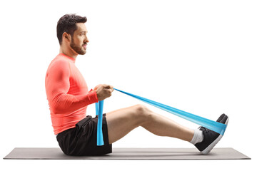 Fit man exercising with an elastic band