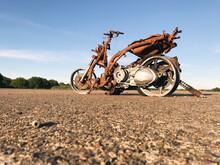 Rusty Scooter In An Empty Field