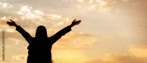 Fototapeta Freedom concept. Happy young woman enjoying freedom with open hands looking to the sky obraz