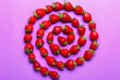 canvas print picture - Composition with ripe strawberry on color background