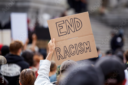 """Sign """"END RACISM"""" at the Police Violence march in Vancouver, BC"""