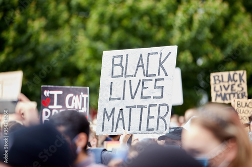 Sign BLACK LIVES MATTER amongst others at the Police Violence march for George Canvas-taulu