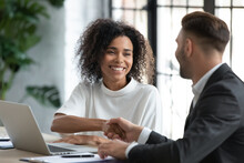 Smiling African American Businesswoman Advisor Broker Shaking Client Customer Hand At Meeting, Making Great Deal After Successful Negotiations, Executive Mentor Greeting New Worker Intern