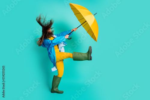 Slika na platnu Full length profile photo of shocked lady stormy rainy weather walk street hold
