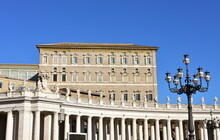 Bernini's Colonnade And Apostolic Palace With The Papal Apartments At The St. Peter's Square. Rome, Italy.