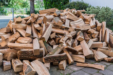 Messy Pile Of Firewood On A Dr...
