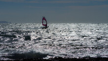 A Windsurfer Is Racing Over The Rough Mediterranean Sea