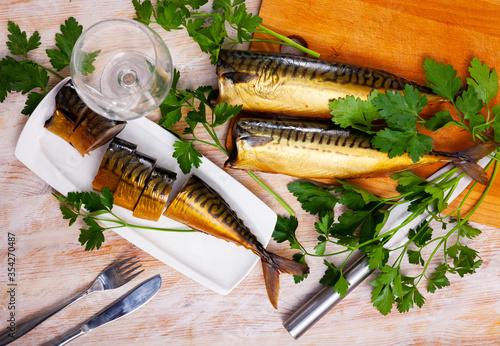 Fototapeta Sliced smoked mackerel with parsley obraz