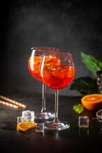 Aperol Spritz Cocktail In Glass With Fresh Orange On Dark Background