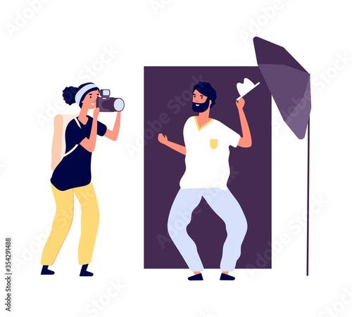 Fototapeta Photo studio. Actor posing photographer. Professional photo session for portfolio with equipment and accessories. Flat style smiling man vector illustration. Photo studio, photographer professional obraz