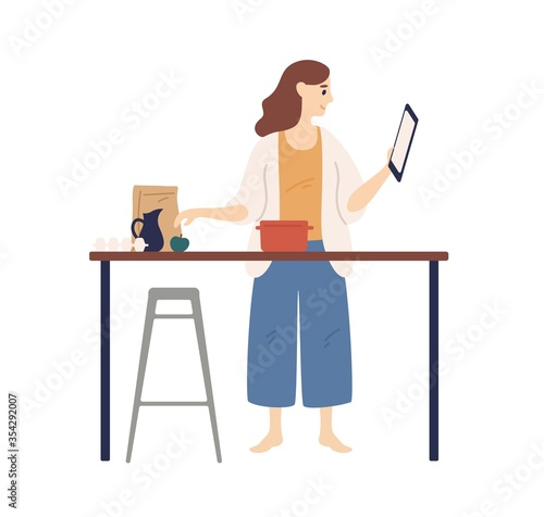 Fototapeta Housewife looking recipe holding tablet during cooking at kitchen vector flat illustration. Domestic woman surfing internet preparing food isolated on white. Female watching tutorial video obraz