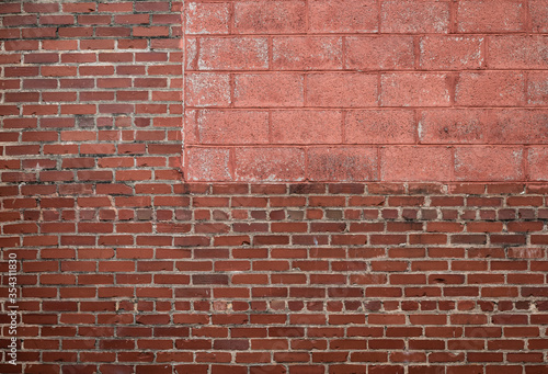 Panorama background of mixed red brick and painted concrete blocks, horizontal aspect